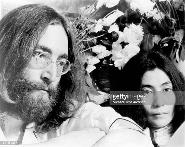 Beatles singer songwriter and guitarist John Lennon and his wife of a week Yoko Ono stage a 'bedin' for peace The couple stayed in bed for seven days...
