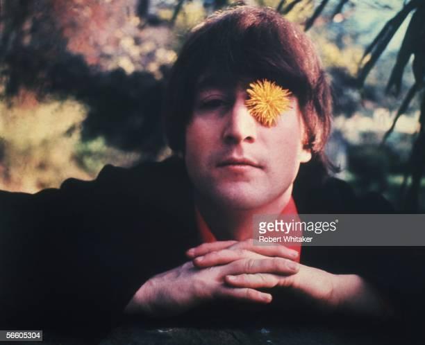 Beatles singer songwriter and guitarist John Lennon He has a dandelion covering his left eye 1966