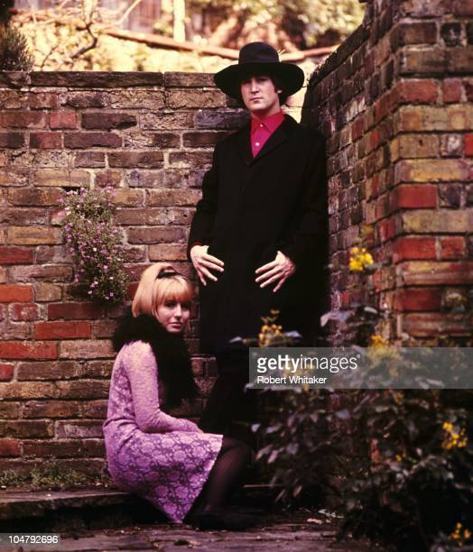 Beatles singer songwriter and guitarist John Lennon with his first wife Cynthia in the garden of their home at Kenwood Weybridge Surrey 1964