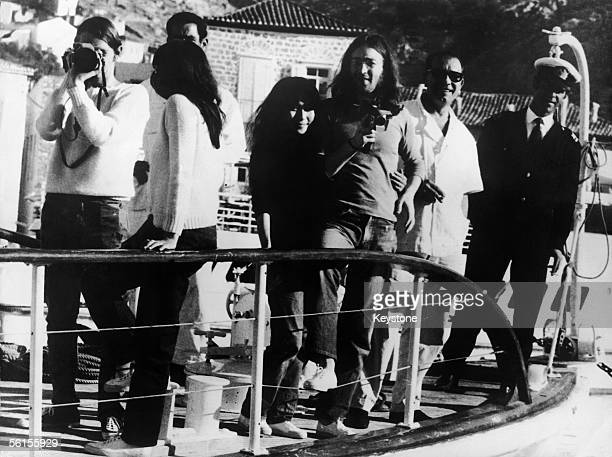 Beatles singer songwriter John Lennon and his wife Yoko Ono on board a yacht at Spetses Island during their cruise of the Aegean Sea 15th November...