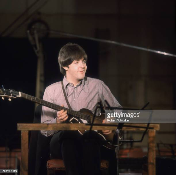 Beatles singer songwriter Paul McCartney playing the guitar during the Abbey Road session to record Paperback Writer and Rain April 1966