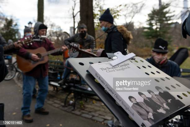 Beatles songbook is left on a music stand near musicians on the 40th anniversary of John Lennon's death at Strawberry Fields, Central Park on...