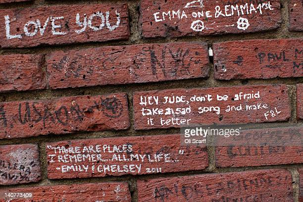 Beatlesthemed graffiti on the wall of Abbey Road Studios in St John's Wood on March 5 2012 in London England Abbey Road in North London has been made...