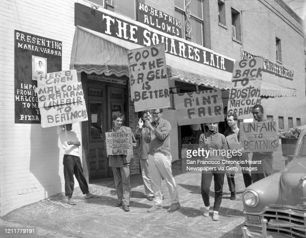 """Beatnik pickets protest the Squares Lair .. Which has a sign, """"No Beatniks Allowed"""" ;Another sign says """"Herb Caen Malcolm unfair to Beatniks"""" ;"""