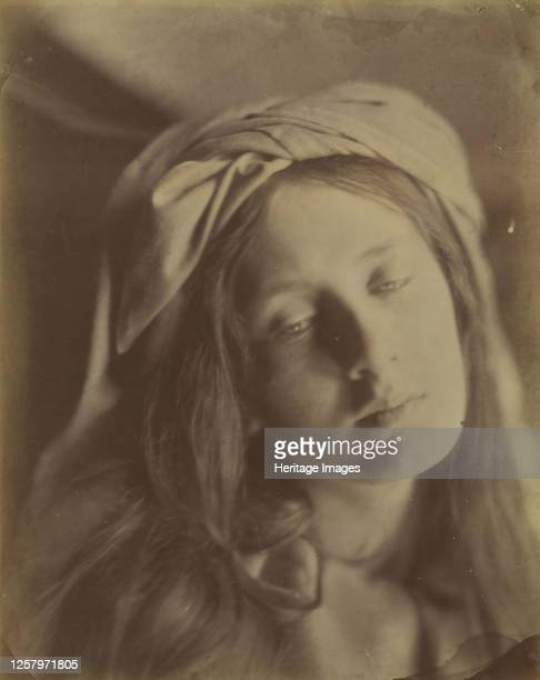 Beatrice 1866 The model has her hair loose with a turban at the top of her head Cameron based the models pose drapery and sad expression on a...