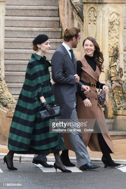 Beatrice Borromeo, Pierre Casiraghi and Alexandra of Hanover arrive at the Monaco Cathedral during the Monaco National Day Celebrations on November...