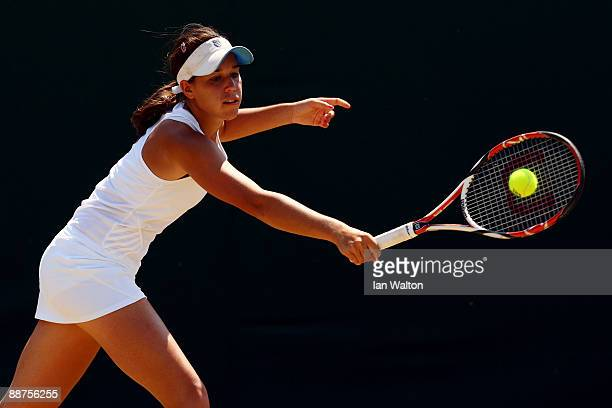 Beatrice Capra of USA plays a backhand during the girl's singles second round match against Tamara Curovic of Serbia on Day Eight of the Wimbledon...