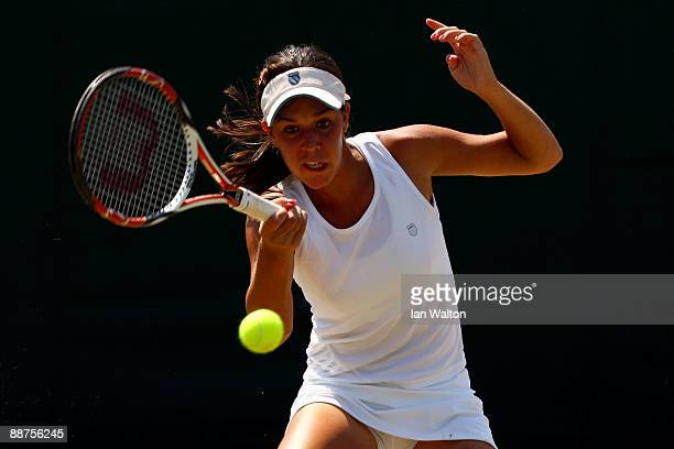 Beatrice Capra of USA plays a forehand during the girl's singles second round match against Tamara Curovic of Serbia on Day Eight of the Wimbledon...