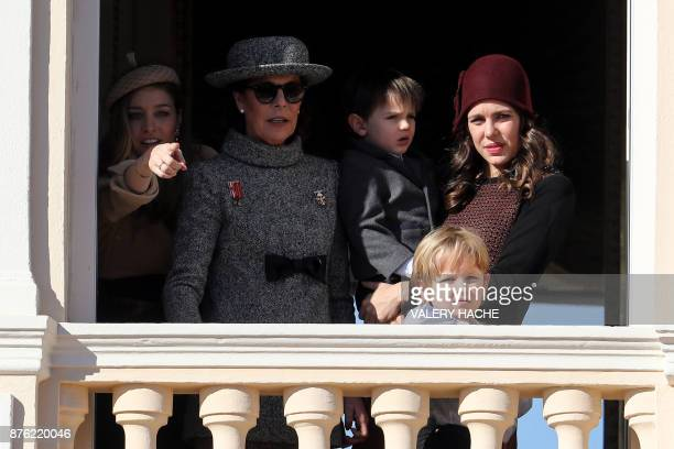 Beatrice Casiraghi Princess Caroline of Hanover Sacha Casiraghi and Charlotte Casiraghi with his son Raphael greet the crowd from the palace's...