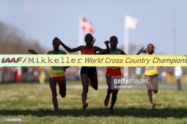 Beatrice Chebet of Kenya approach the line to win the Women's U20 Final as Alemitu Tariku of Ethiopia reacts to coming second during the IAAF World...