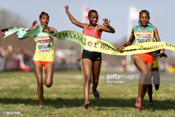 Beatrice Chebet of Kenya crosses the line to win the Women's U20 Final as Alemitu Tariku of Ethiopia reacts to coming second during the IAAF World...