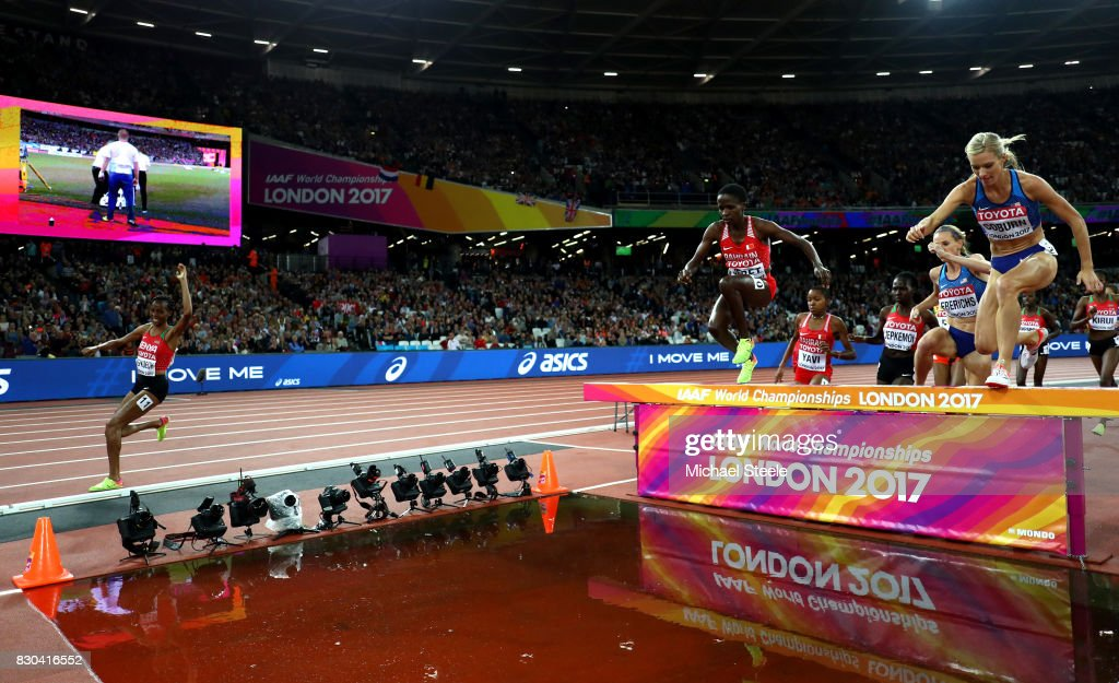 Beatrice Chepkoech of Kenya misses the water jump as Emma Coburn of the United Statesand Courtney Frerichs of the United States compete in the Women's 3000 metres Steeplechase final during day eight of the 16th IAAF World Athletics Championships London 2017 at The London Stadium on August 11, 2017 in London, United Kingdom.