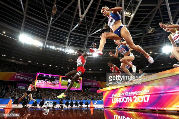 Beatrice Chepkoech of Kenya misses the water jump as Emma Coburn of the United States and Courtney Frerichs of the United States compete in the...