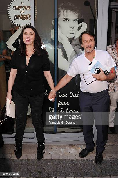 Beatrice Dalle and JeanHugues Anglade attend the 8th Angouleme FrenchSpeaking Film Festival on August 29 2015 in Angouleme France