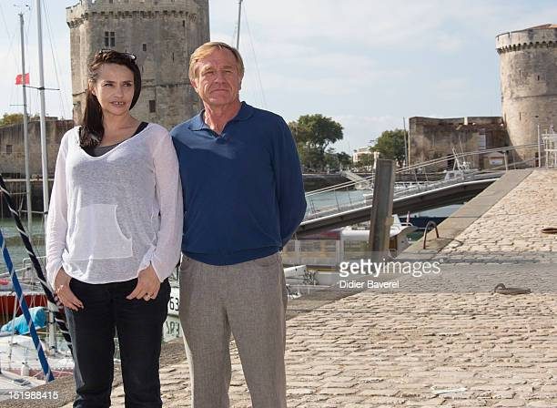 Beatrice Dalle and President of festival Quentin Raspail pose during the 'Punk' Photocall at La Rochelle Fiction Television Festival on September 14...
