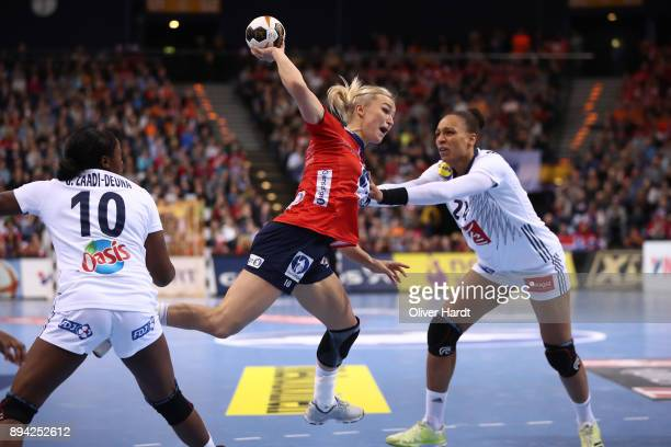 Beatrice Edwige of France and Stine Bredal Oftedal of Norway challenges for the ball during the IHF Women's Handball World Championship final match...