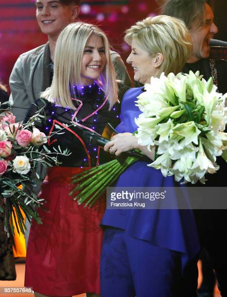 Beatrice Egli and Carmen Nebel during the tv show 'Willkommen bei Carmen Nebel' on March 24 2018 in Hof Germany The show will be aired on March 24...