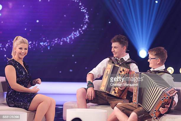 Beatrice Egli and Magnus and Quirin Kapfhammer 'Kapfhammer Buam' perform on stage during the taping of the tv show 'Beatrice Egli Die grosse Show der...
