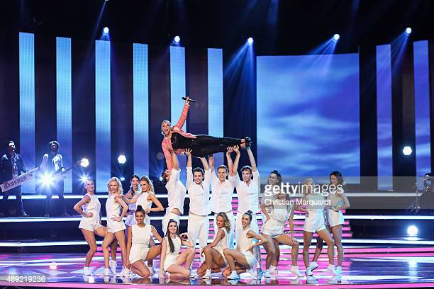 Beatrice Egli performs on stage at the television show 'Willkommen bei Carmen Nebel' at Velodrom on September 19 2015 in Berlin Germany