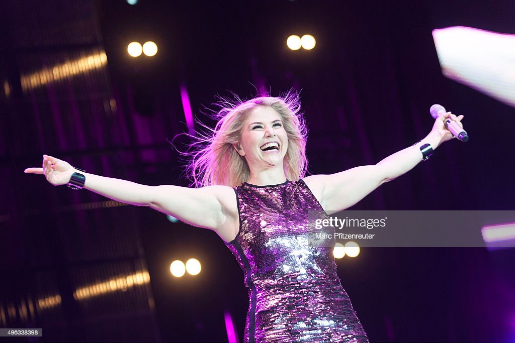 Beatrice Egli performs onstage during the 'Schlager-Starparade' at the Koenig-Pilsener-Arena on November 8, 2015 in Oberhausen, Germany.