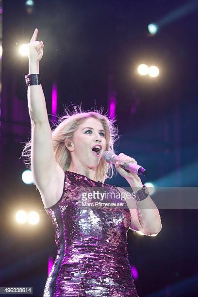 Beatrice Egli performs onstage during the 'SchlagerStarparade' at the KoenigPilsenerArena on November 8 2015 in Oberhausen Germany
