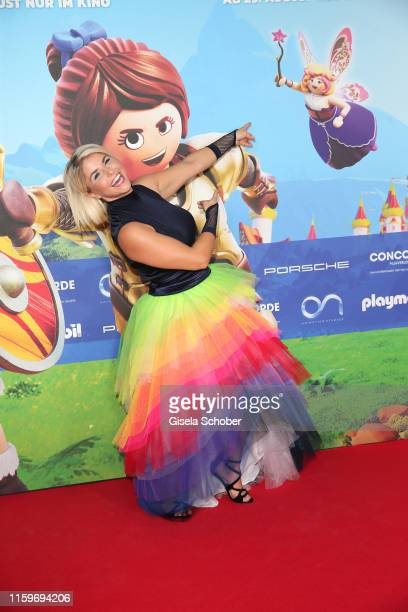 Beatrice Egli wearing a rainbow skirt during the premiere of the movie Playmobil der Film at Mathaeser Filmpalast on August 4 2019 in Munich Germany
