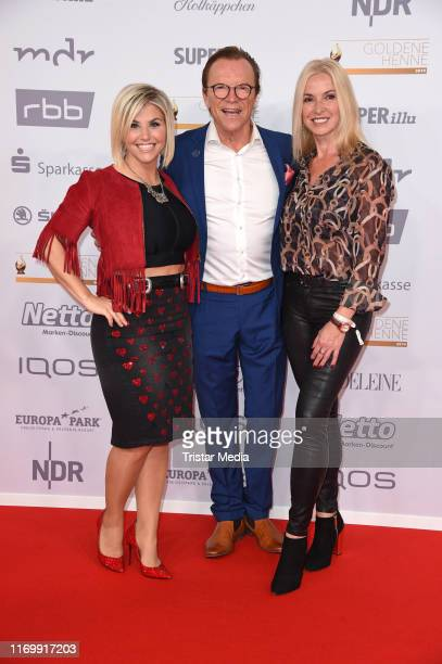 Beatrice Egli, Wolfgang Lippert and his wife Gesine Lippert attend the 'Goldene Henne' red carpet at Messe Leipzig on September 20, 2019 in Leipzig,...