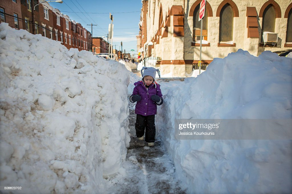 Beatrice Evangeline, 3, walks through a narrow shoveled path on January 24, 2016 in Philadelphia, Pennsylvania. Millions of people are digging themselves out after a record snow storm affected most of the Mid Atlantic States.