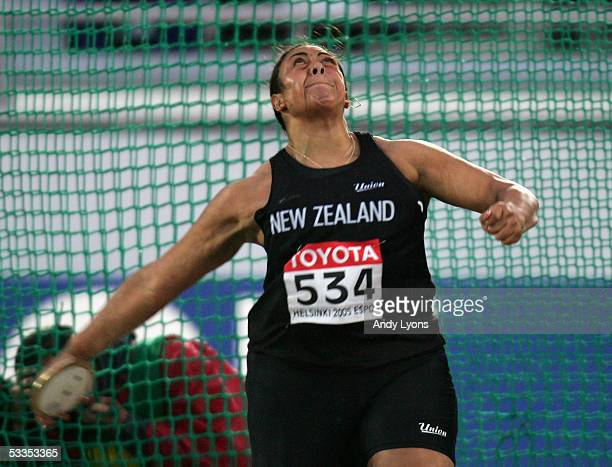 Beatrice Faumuina of New Zeeland competes during the women's Discus Throw final at the 10th IAAF World Athletics Championships on August 11 2005 in...