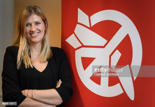 Beatrice Fihn executive director of 2017 Nobel Peace Prizewinning International Campaign to Abolish Nuclear Weapons poses next to the ICAN logo at...