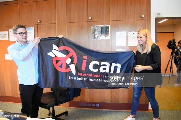Beatrice Fihn executive director of the International Campaign to Abolish Nuclear Weapons celebratetes with a staff after the Nobel Peace Prize is...