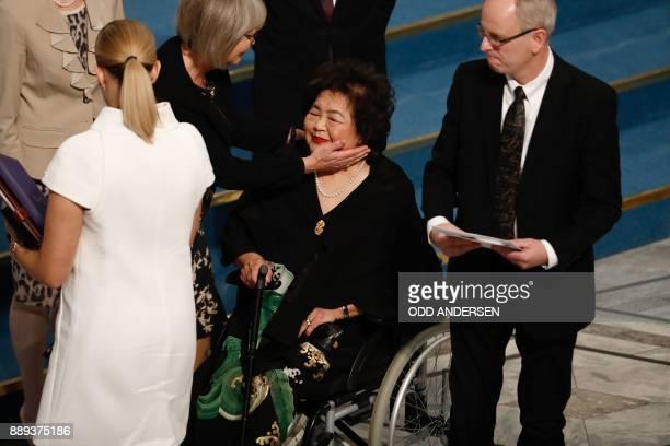 Beatrice Fihn leader of ICAN and Norwegian Nobel Committee member Henrik Syse look on as Nobel Committee member Tone Jorstad comforts Hiroshima...