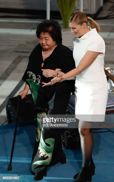 Beatrice Fihn leader of ICAN helps Hiroshima nuclear bombing survivor Setsuko Thurlow to leave the podium during the award ceremony of the 2017 Nobel...