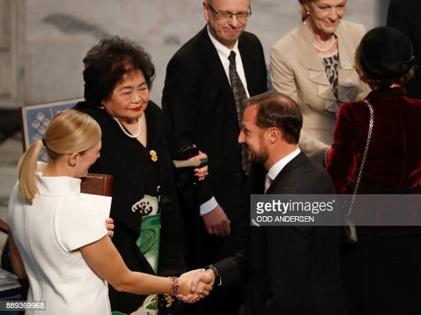 Beatrice Fihn leader of ICAN is congratulated by Crown Prince Haakon of Norway as Hiroshima nuclear bombing survivor Setsuko Thurlow looks on during...