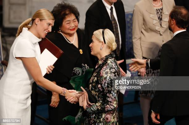 Beatrice Fihn leader of ICAN is congratulated by Crown Princess MetteMarit of Norway as Hiroshima nuclear bombing survivor Setsuko Thurlow looks on...
