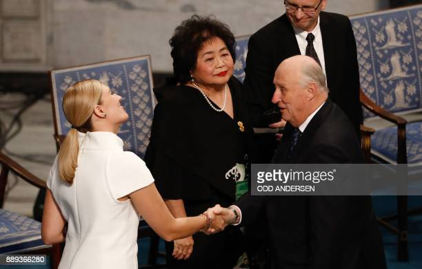 Beatrice Fihn leader of ICAN is congratulated by King Harald V of Norway as Hiroshima nuclear bombing survivor Setsuko Thurlow looks on during the...