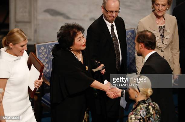 Beatrice Fihn leader of ICAN looks on as Hiroshima nuclear bombing survivor Setsuko Thurlow is congratulated by Crown Prince Haakon of Norway during...