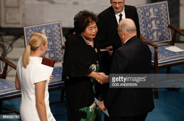Beatrice Fihn leader of ICAN looks on as King Harald V of Norway congratulates Hiroshima nuclear bombing survivor Setsuko Thurlow during the award...