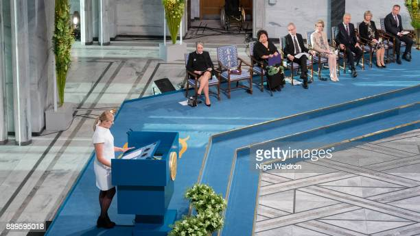 Beatrice Fihn the Executive Director International Campaign to Abolish Nuclear Weapons delivers her acceptance speech in front of Berit ReissAndersen...
