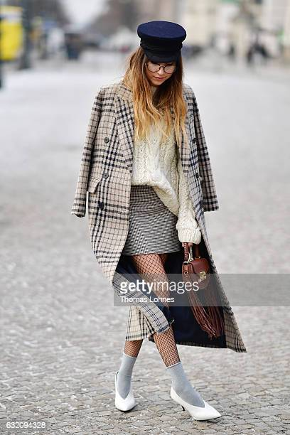 Beatrice Guta wearing Vintage from Mango and a Salar Milano bag poses for photographs during the MercedesBenz Fashion Week Berlin A/W 2017 at...