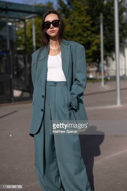 Beatrice Gutu is seen on the street during Paris Haute Couture Fashion Week wearing sea green Acne Studios blazer and pants with white shirt and...