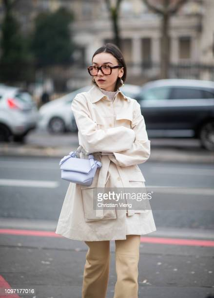 Beatrice Gutu is seen wearing creme white belted coat outside Acne during Paris Fashion Week - Menswear F/W 2019-2020 Day Six on January 20, 2019 in...
