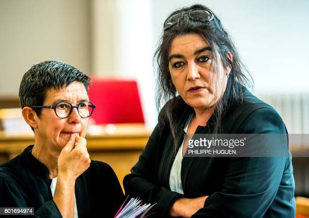 Beatrice Huret the widow of a French police officer and a former activist of the farright Front National party talks with her lawyer MarieHelene...