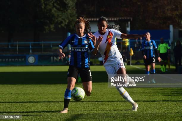 Beatrice Merloof FC Internazionale Women competes for the ball with Lindsey Thomas of AS Roma Women during the Women Serie A match between FC...