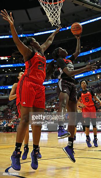 Beatrice Mompremier of the East team shoots against Kalani Brown of the West team during the 2015 McDonalds's All American Game at the United Center...