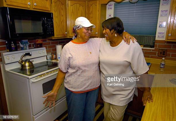 AURORA CO SEPTEMBER 6 2005 Beatrice Scott left recounted how her family including daughter YE Scott right embraced her at Denver International...