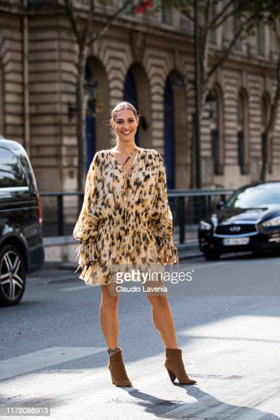 Beatrice Valli, wearing a printed dress and brown boots, is seen outside the Redemption show during Paris Fashion Week - Womenswear Spring Summer...
