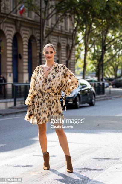 Beatrice Valli wearing a printed dress and brown boots is seen outside the Redemption show during Paris Fashion Week Womenswear Spring Summer 2020 on...