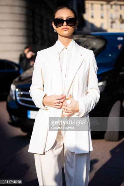 Beatrice Vendramin, wearing a white suit and white shirt, is seen outside Salvatore Ferragamo show, during Milan Fashion Week Fall/Winter 2020-2021...