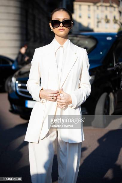 Beatrice Vendramin, wearing a white tailleur, is seen outside Salvatore Ferragamo show, during Milan Fashion Week Fall/Winter 2020-2021 on February...